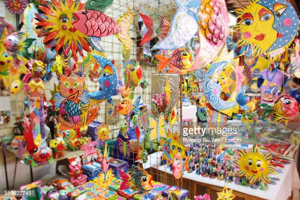 multi colored toys for sale at market stall - eyeem collection stock pictures, royalty-free photos & images