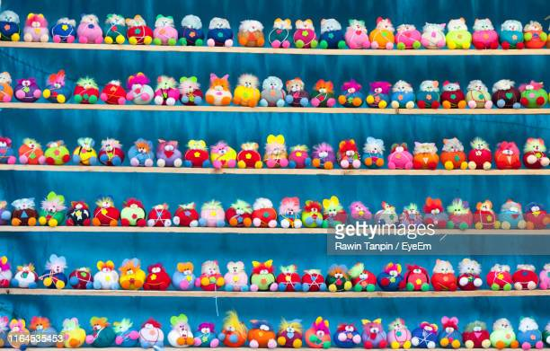 multi colored toys in store for sale - collection stock pictures, royalty-free photos & images