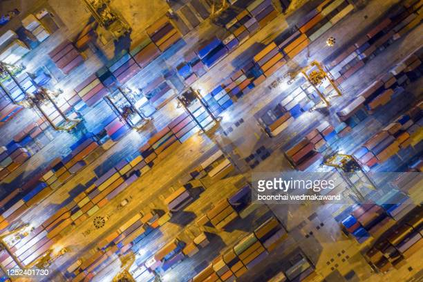 multi colored transportation containers just about to be loaded on business transportation vessels. - controllato a distanza foto e immagini stock
