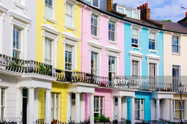 multi colored vibrant houses in primrose hill neighborhood, london, uk - british culture stock pictures, royalty-free photos & images