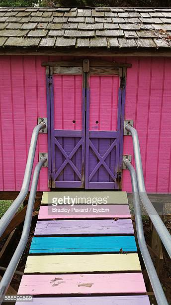 multi colored walkway leading towards playhouse - pavard stock pictures, royalty-free photos & images