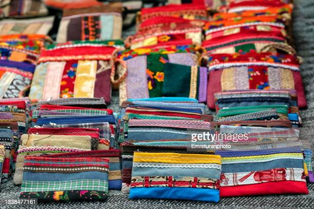 multi colored womans wallets on a stand in the market. - emreturanphoto stock pictures, royalty-free photos & images