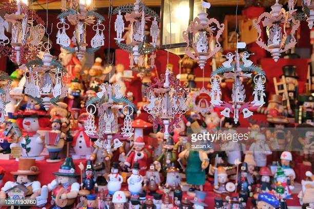 multi colored wooden figurines on sale at the christmas market stall. - souvenir stock pictures, royalty-free photos & images