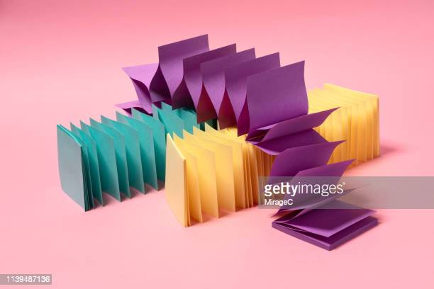 multi colored zigzag paper stretching - beweglichkeit stock-fotos und bilder