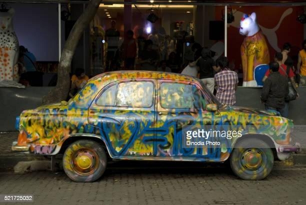 Multi colour painted ambassador car at Linking Road Khar, Mumbai, Maharashtra, India
