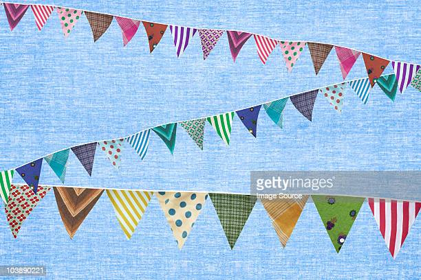 Multi coloured bunting against blue background