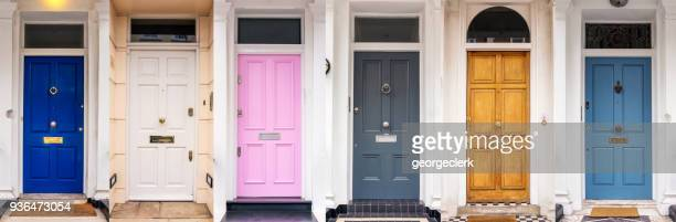 multi coloured doors of london - in a row stock pictures, royalty-free photos & images