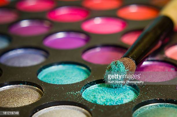 multi coloured eye shadow palette and brush - artist's palette stock photos and pictures