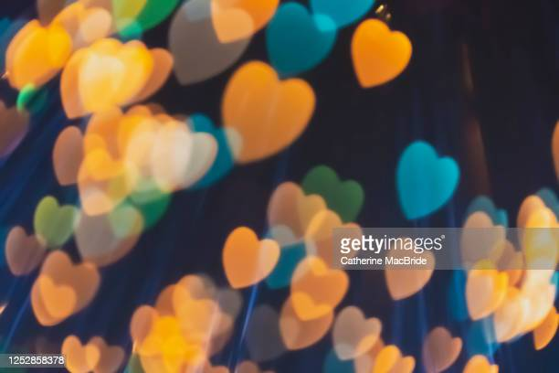 multi coloured heart shaped light bokeh - catherine macbride stock pictures, royalty-free photos & images