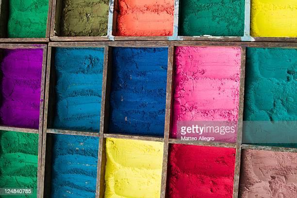 Multi coloured powders in container