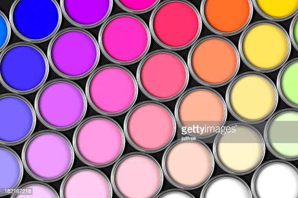 Multi coloured rows of paint tins on black