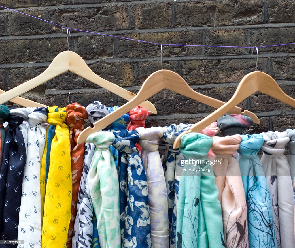 Multi coloured scarves for sale on hangers : Stock Photo