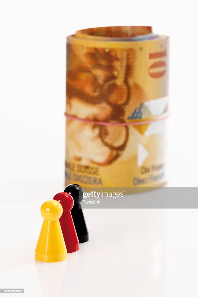Multi coloured  tokens with swiss francs in background : Stock Photo