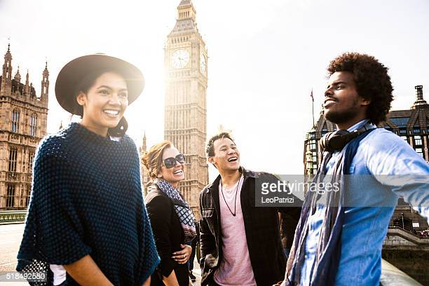 multi cultural group of friends hanging out in central london - westminster bridge stock pictures, royalty-free photos & images