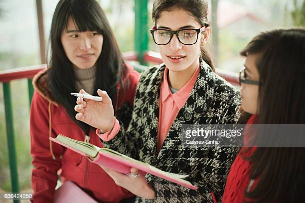 multi ethnic asian university students teaching and learning together. - indian college girls stock photos and pictures