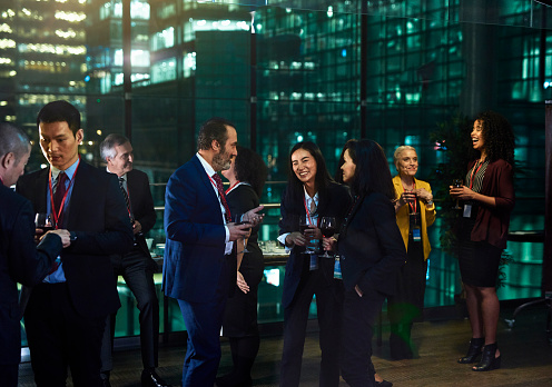 Multi ethnic business colleagues socialising at office party - gettyimageskorea