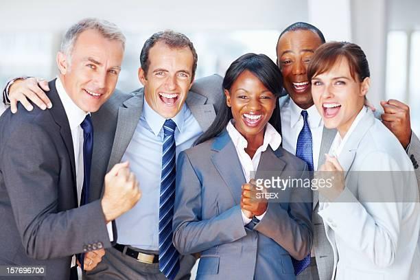Multi ethnic business people celebrating success