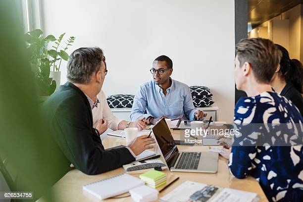 Multi ethnic business people discussing in office