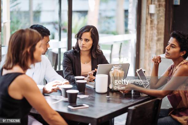 multi ethnic business people on the business meeting - minority groups stock pictures, royalty-free photos & images