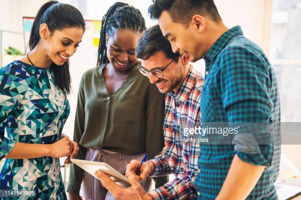 multi ethnic business team gathering - minority groups stock pictures, royalty-free photos & images