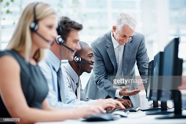 Multi ethnic business team working in a call center
