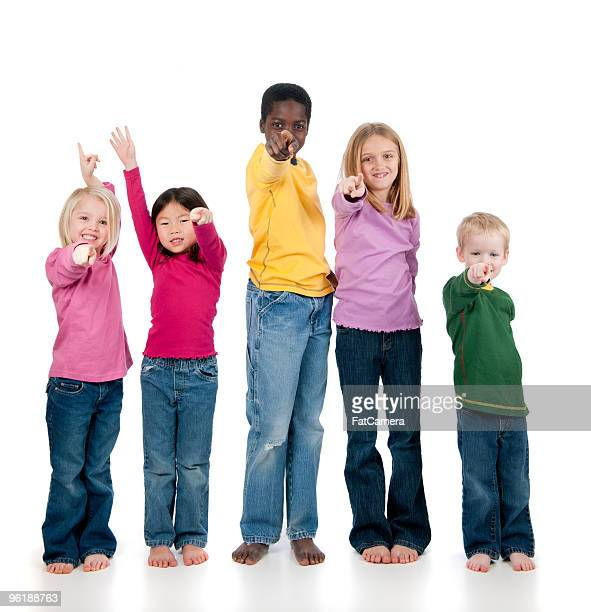 multi ethnic children - pointing at camera stock photos and pictures