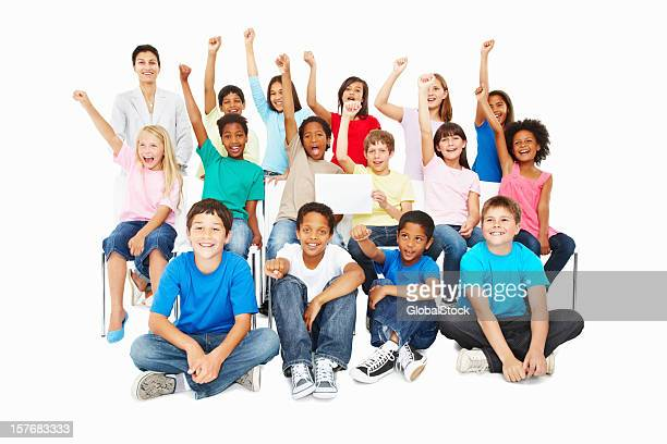 Multi ethnic children with hands raised holding a billboard