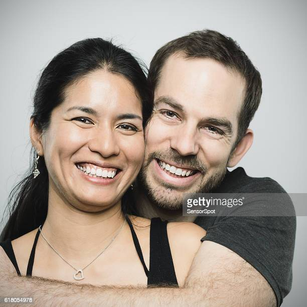 Multi ethnic couple in love portrait.