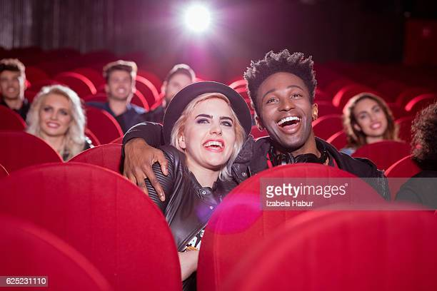 Multi ethnic couple in the movie theater