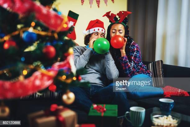Multi ethnic couple in UK celebrating Christmas