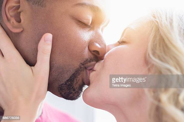 multi ethnic couple kissing - black men kissing white women stock photos and pictures