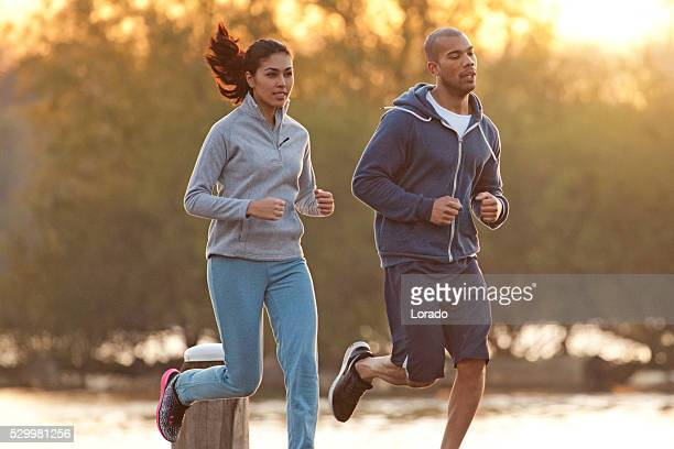 Multi ethnic couple running during a morning workout