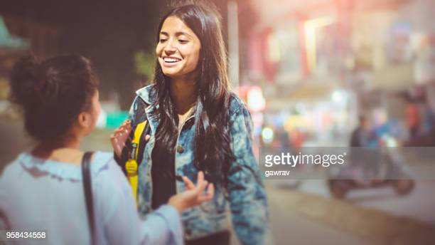 multi ethnic female friends together on street at evening. - letter s stock pictures, royalty-free photos & images