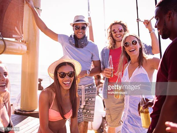 Multi ethnic friends laughing and smiling on a yacht