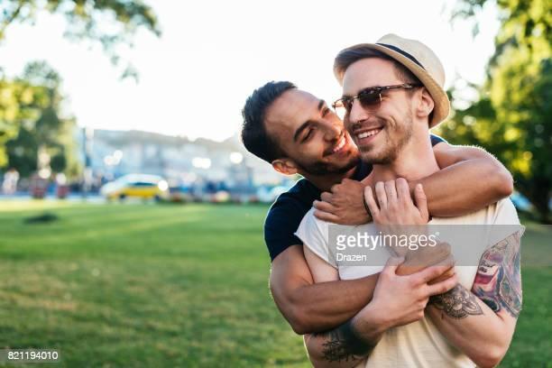 Multi ethnic gay couple hugging
