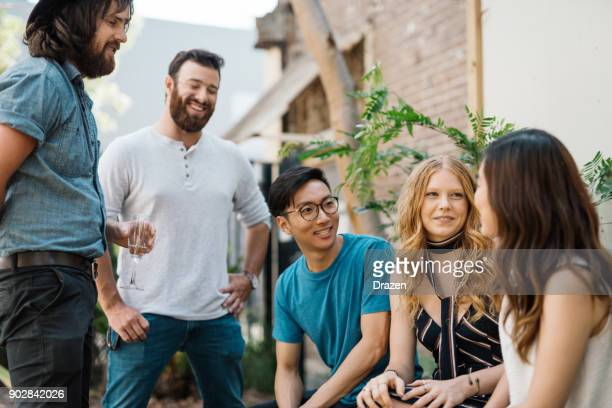 multi ethnic group of beautiful people in australian garden - community stock pictures, royalty-free photos & images