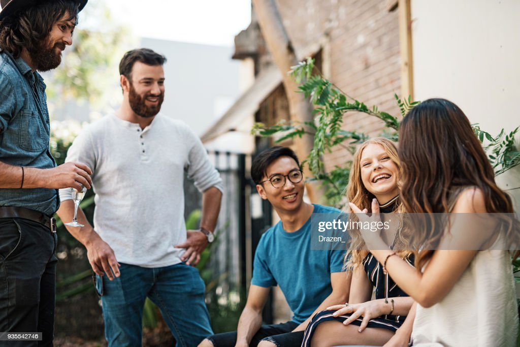Multi ethnic group of beautiful people in Australian garden : Stock Photo