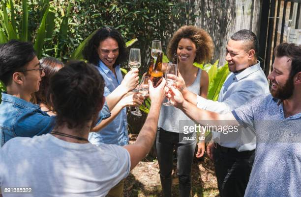 Multi Ethnic group of people having drink party.