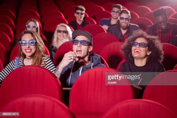 Multi ethnic group of people in the 3D movie theater
