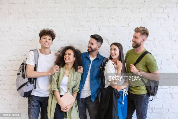 multi ethnic group of students - izusek stock pictures, royalty-free photos & images