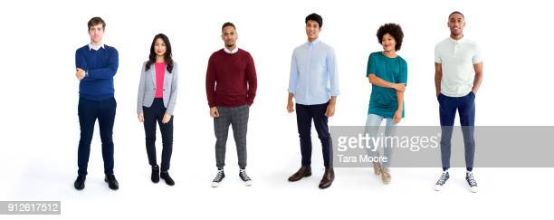 multi ethnic group of young adults - in a row stock pictures, royalty-free photos & images