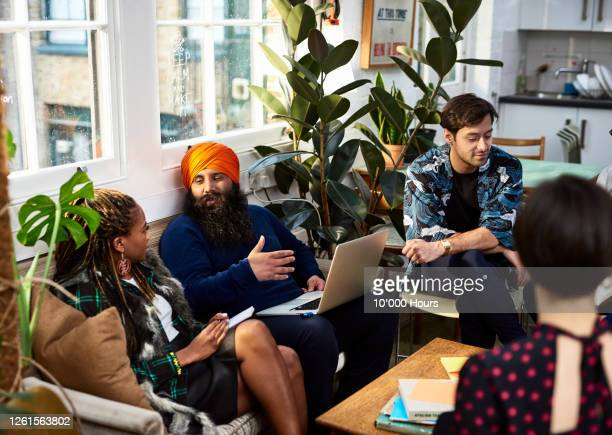 multi ethnic group sharing ideas for new business - community stock pictures, royalty-free photos & images