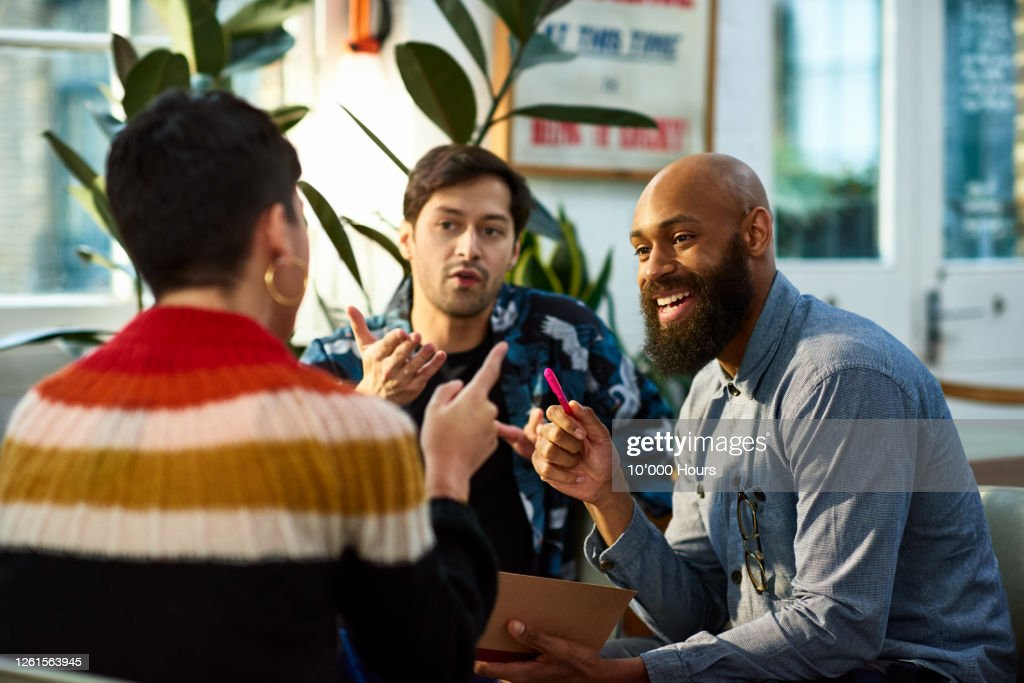 Multi ethnic group sharing ideas in office : Photo