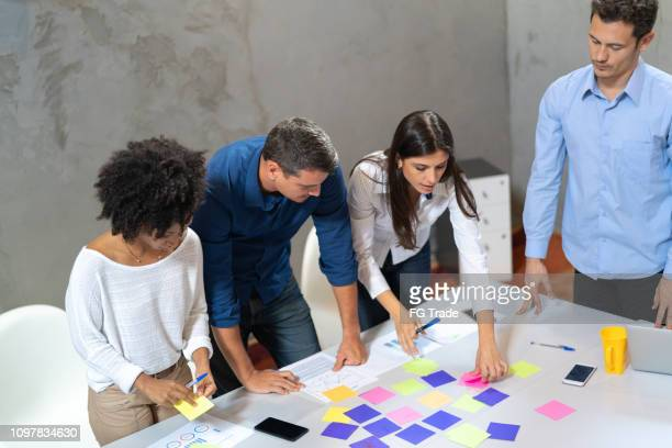 multi ethnic people during business meeting - graphic design stock pictures, royalty-free photos & images