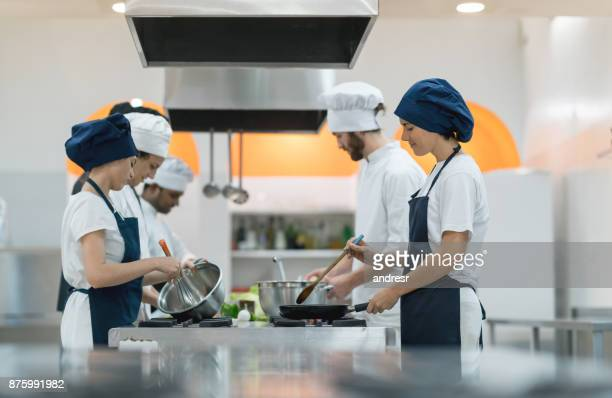 Multi ethnic team of cooks working at the kitchen