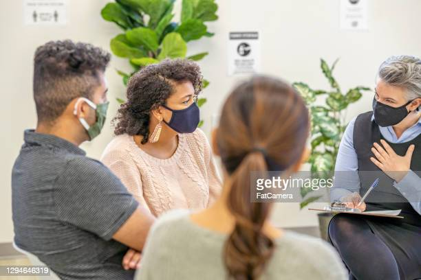 multi ethnic therapy group during pandemic - fatcamera stock pictures, royalty-free photos & images