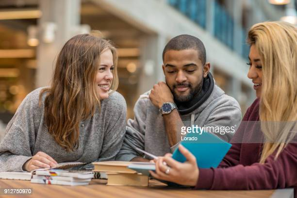 multi ethnic university adult students learning languages together in a study hall - linguistics stock pictures, royalty-free photos & images