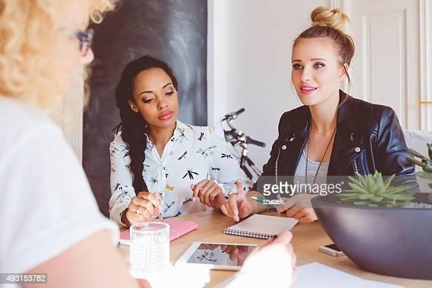 Multi ethnic women team brainstorming