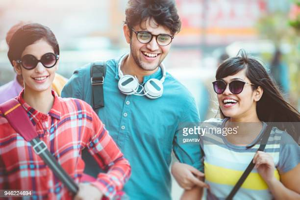Multi ethnic young adult friends together in city.