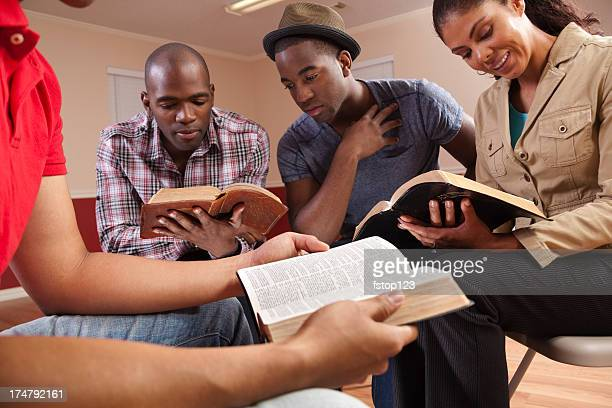 multi ethnic young adults in a bible study. church. group. - church stock pictures, royalty-free photos & images